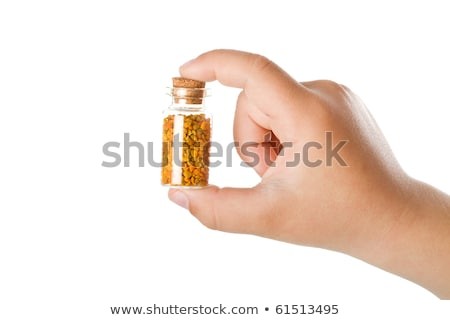 Small bottle with pollen in child hand Stock photo © lightkeeper