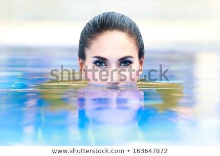 Closeup of woman's head with beach background Stock photo © photography33