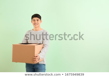 Man carrying a cardboard box on moving day Stock photo © photography33