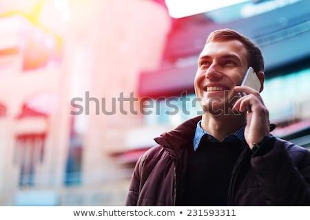 笑みを浮かべて · 男 · 携帯電話 · 徒歩 · 携帯電話 · 電話 - ストックフォト © adamr