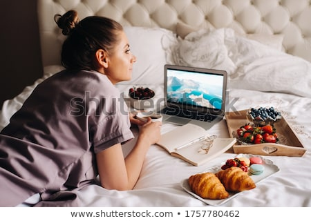 Woman lying on a bed Stock photo © photography33