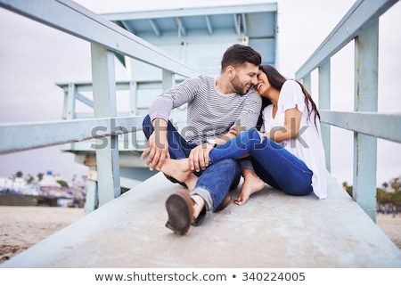Stock fotó: Young Couple Talking On Beach