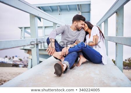 Young couple talking on beach stock photo © Kotenko