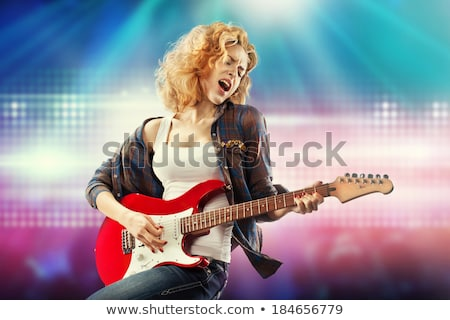 Blond woman holding electric guitar stock photo © photography33