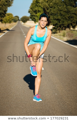 Brunette with sore ankles Stock photo © photography33