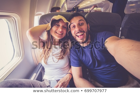 Jóképű fiatalember tábla repülőgép repülés néz Stock fotó © lightpoet