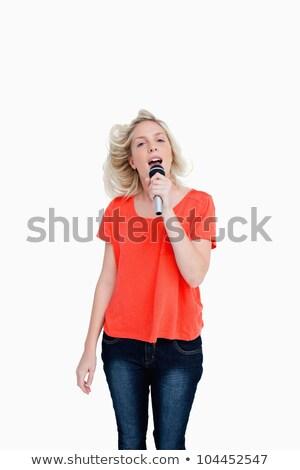 Dynamiczny nastolatek śpiewu karaoke biały zabawy Zdjęcia stock © wavebreak_media