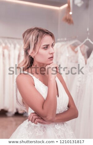 Bride looking thoughtful while holding her chin stock photo © wavebreak_media