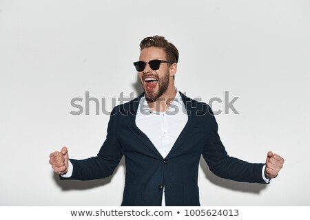Man standing with arms outstretched Stock photo © wavebreak_media