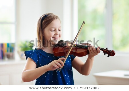 Playing violin Stock photo © zzve