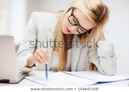 Bored woman taking notes Stock photo © photography33
