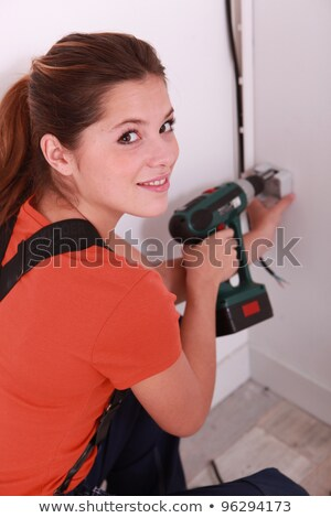Woman with a cordless screwdriver Stock photo © photography33