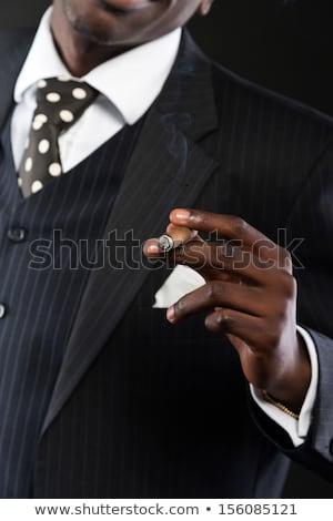 Afro-amerikaanse maffia man roken sigaar handgun Stockfoto © lunamarina