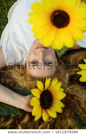 Foto d'archivio: Cute Woman Photographer In Nature Sunflower Field