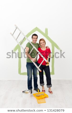 Stock photo: happy couple with painting utensils