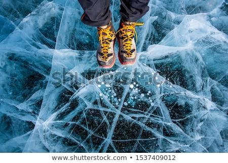 Jég fagyott merő tó sok repedések Stock fotó © zastavkin