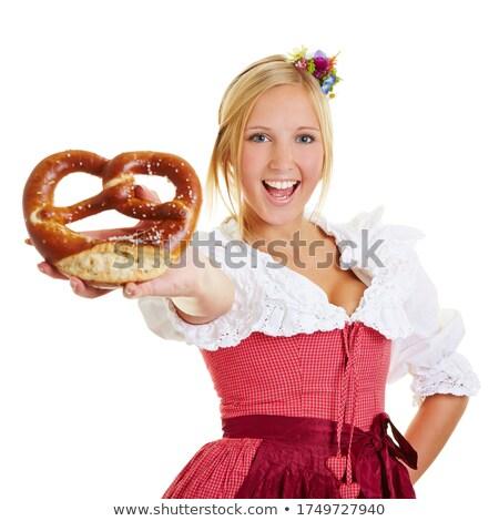 loiro · mulher · jovem · alimentação · pretzel · jovem · mulher · atraente - foto stock © runzelkorn