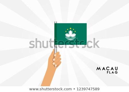 Macau Small Flag on a Map Background. Stock photo © tashatuvango