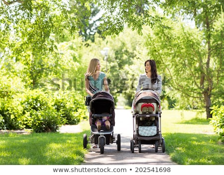 happy mothers with their babies outdoors stock photo © nejron