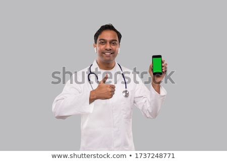 smiling male doctor showing thumbs up Stock photo © dolgachov