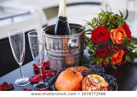 Red rose and cold pomegranate drink on wood table Stock photo © nalinratphi