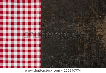 old baking tray with a red checkered tablecloth and cooking utensils stock photo © zerbor