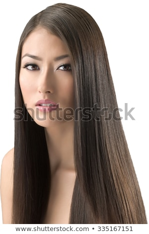 Serious attractive woman with long brown hair Stock photo © dash