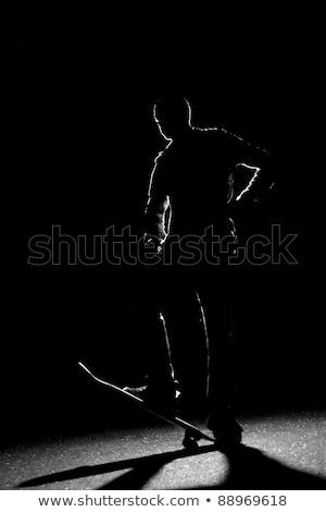 gördeszkás · csávó · sziluett · áll · bent · medence - stock fotó © arenacreative