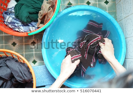 Senior asian woman washing cloths by hand Stock photo © Witthaya