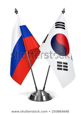 Russia Corea del Sud miniatura bandiere isolato bianco Foto d'archivio © tashatuvango