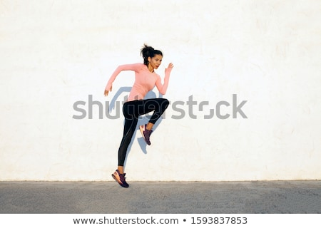 young fitness woman jumping high stock photo © uleiber
