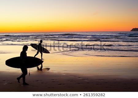 Surfen zonsondergang Portugal silhouet surfer surfboard Stockfoto © joyr
