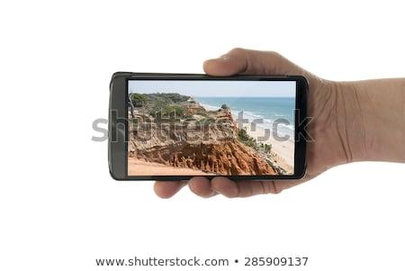 Kadın el cep telefonu yalıtılmış beyaz Stok fotoğraf © compuinfoto