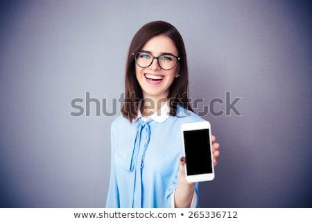 feminino · executivo · tela · sensível · ao · toque · celular · sorridente · câmera - foto stock © deandrobot