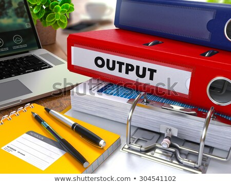 Red Ring Binder with Inscription Output. Stock photo © tashatuvango