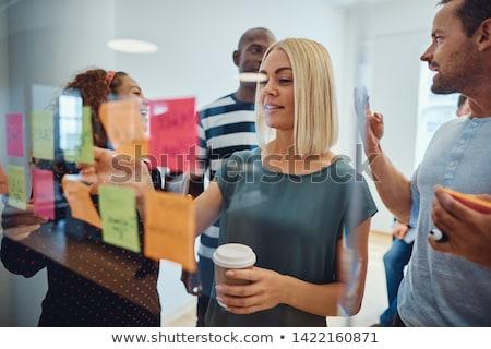 Przypadkowy zespół firmy patrząc karteczki biuro spotkanie Zdjęcia stock © wavebreak_media