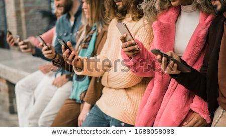 students using their smartphones together stock photo © wavebreak_media