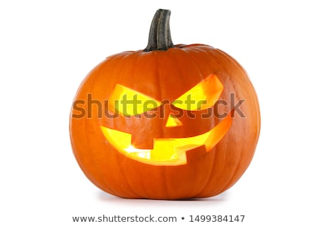 Spooky halloween background with evil face of jack o lantern in the corner Stock photo © dla4