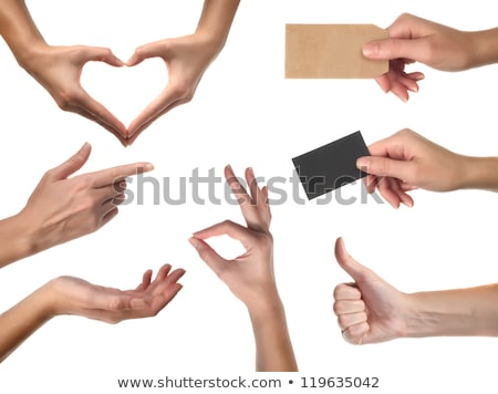 Womans hand with pointer finger holding blank card Stock photo © cherezoff