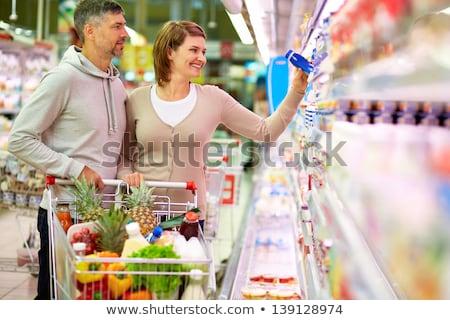 sonriendo · joven · mujer · comprar · pina · supermercado - foto stock © Paha_L