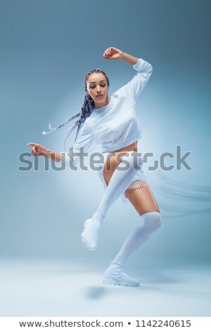 Attractive excited fitness girl in sportwear jumping of joy  Stock photo © deandrobot