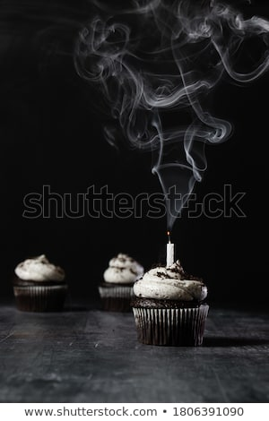birthday cupcake with candles blown out stock photo © frannyanne