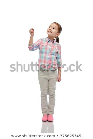 Lány felfelé néz tart valami láthatatlan gyermekkor Stock fotó © dolgachov