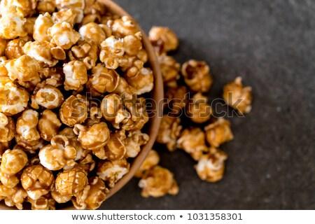 Caramelo maíz vidrio tazón palomitas dulces Foto stock © Digifoodstock