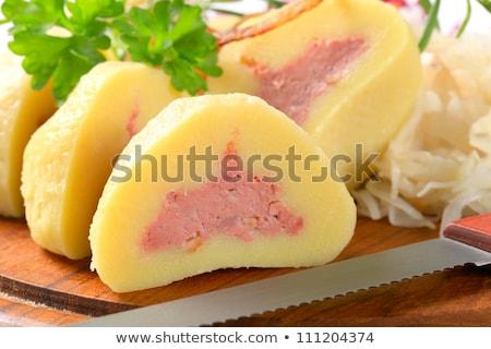 Meat stuffed potato dumplings with shredded cabbage Stock photo © Digifoodstock