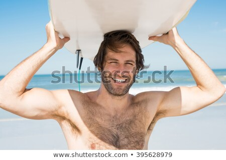 Close up face of handsome guy with surfboard on head Stock photo © deandrobot
