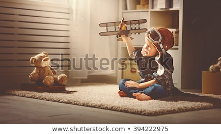 happy little kid playing with bear toy stock photo © zurijeta