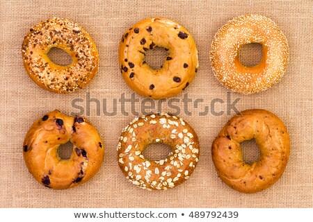 Six different tasty fresh bagels on burlap Stock photo © ozgur