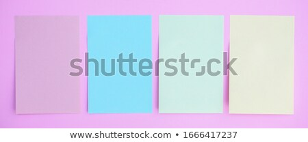 A topview of a pad of yellow post-it Stock photo © bluering