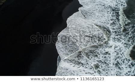 черный · вулканический · пляж · пейзаж · волны · тень - Сток-фото © ruslanomega